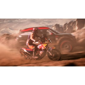 A motorcycle and a car racing in Dakar 18