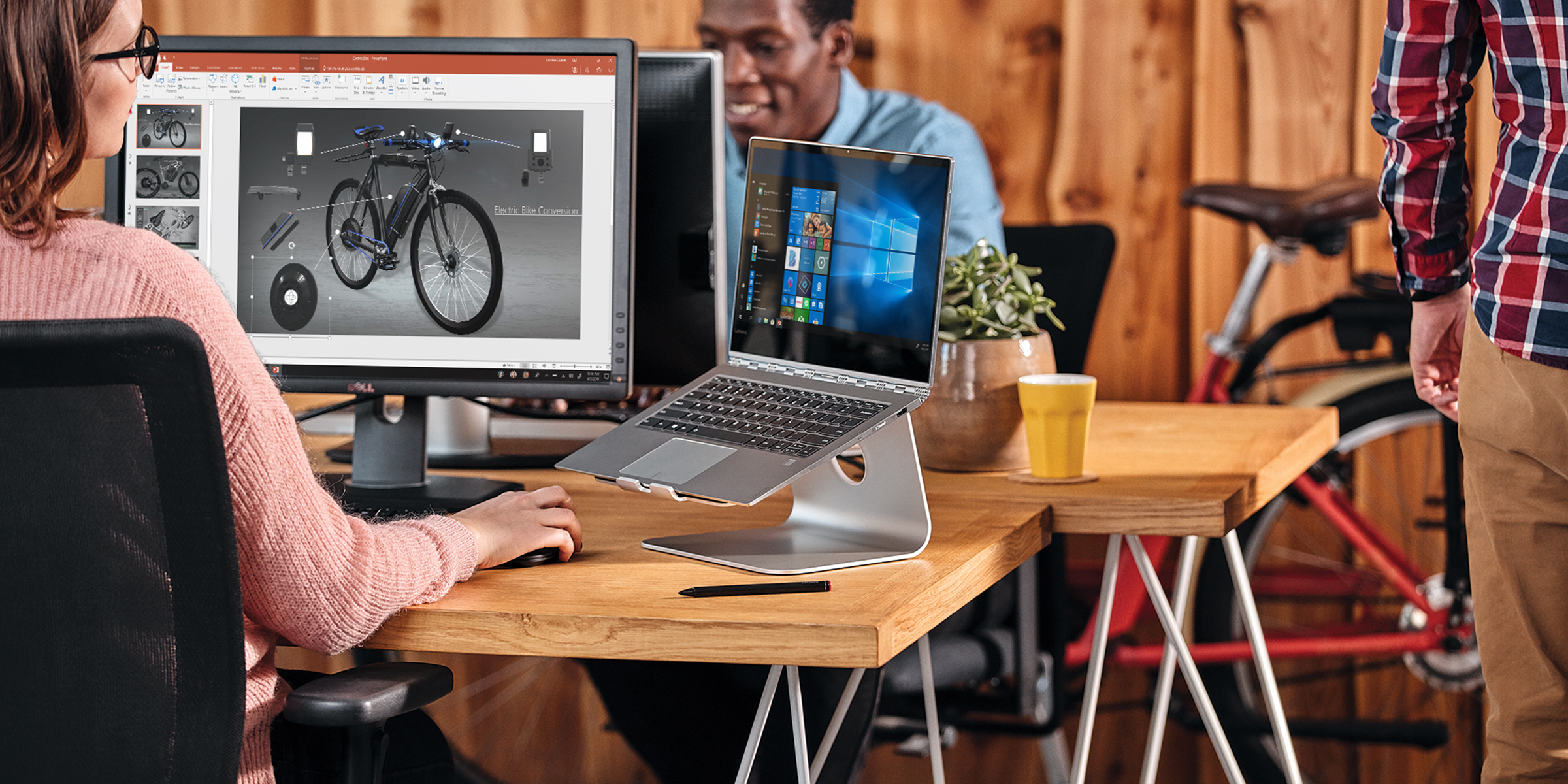 woman at desk with bicycle on screen