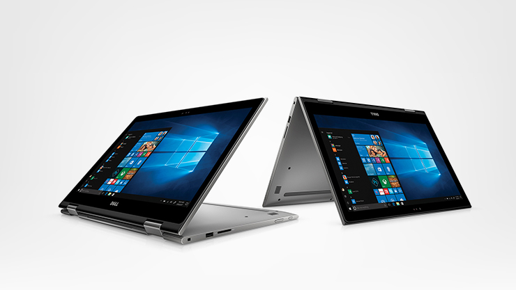 Two Dell XPS 15 2-1 laptop PCs displaying Windows 10