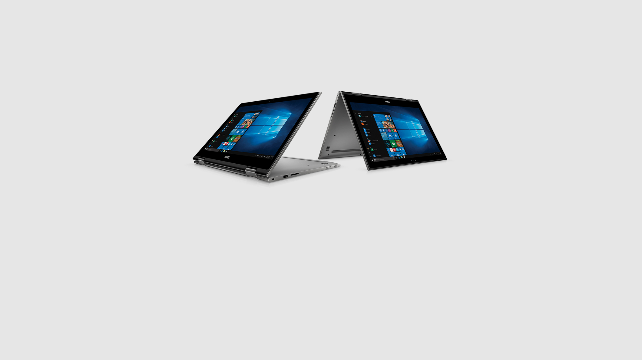 Two Dell XPS 15 2-in-1 laptop PCs displaying Windows 10