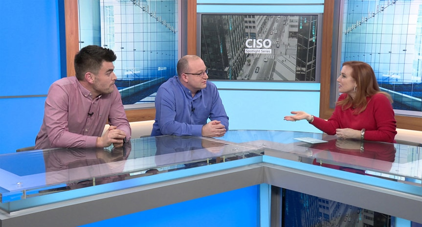 CISO Spotlight Series host Theresa Payton talking to two people on the set of the video series