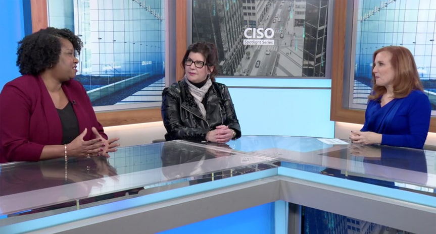 CISO Spotlight Series host Theresa Payton talking to Microsoft Cybersecurity Solutions CVP Ann Johnson and one other person on the set of the video series