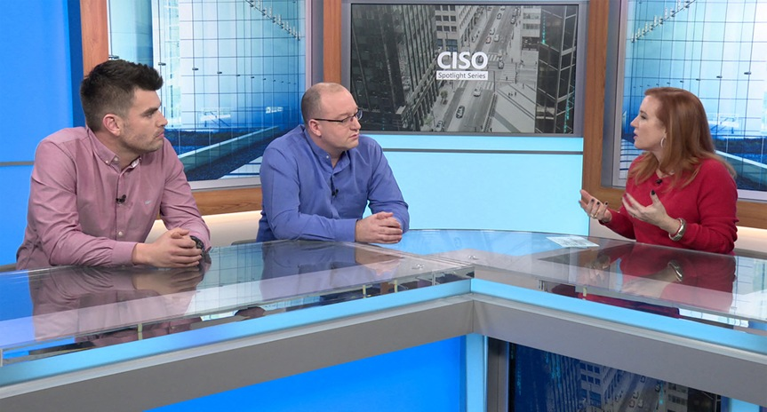 Still image from video with Theresa Payton, Mark Simos, and David Weston seated at a counter in a professional studio setting with CISO Spotlight Series and CISO city image in background.