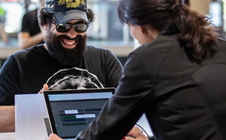 Man with sunglasses smiling at Microsoft Ignite