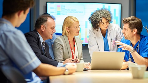 group of healthcare professionals collaborating in a conference room setting
