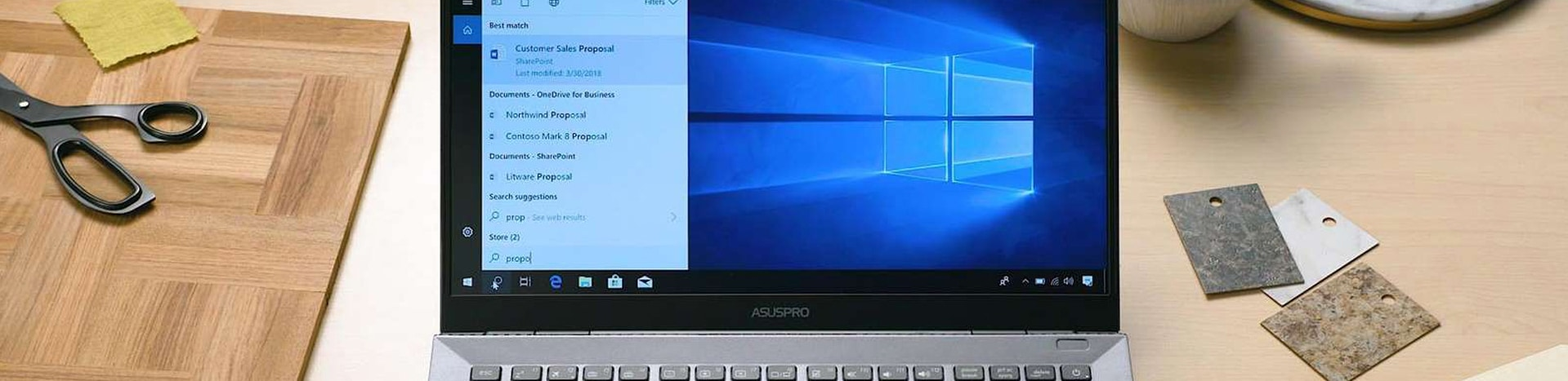 Laptop on a table with Microsoft Search in Windows on screen