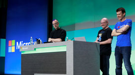 Three managers sharing the stage presenting the Microsoft BI power hour
