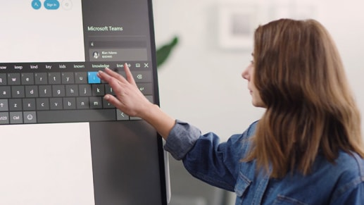 A person uses touch to interact with Surface Hub 2S