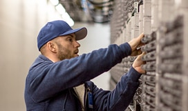 IT pro working on a server stack in a datacenter