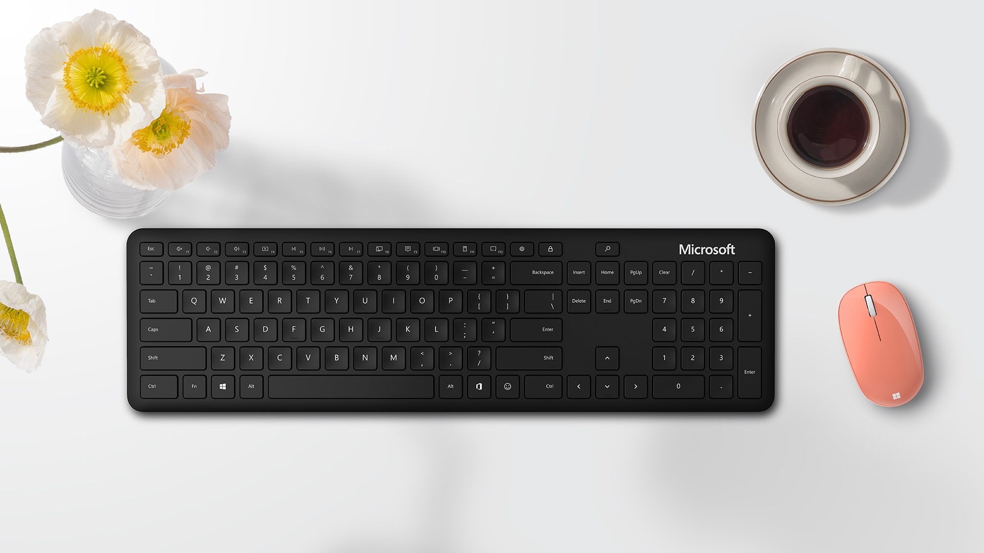 A Microsoft Bluetooth® Keyboard and a Microsoft Bluetooth® Mouse sit on a desk.