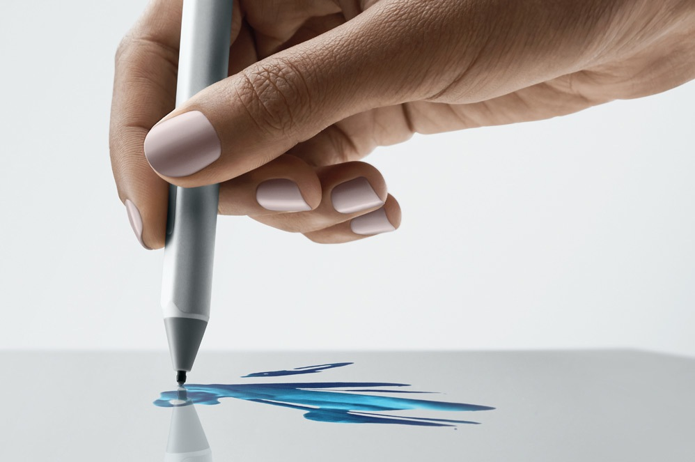 A person inks with Surface Pen on the screen of a Surface device