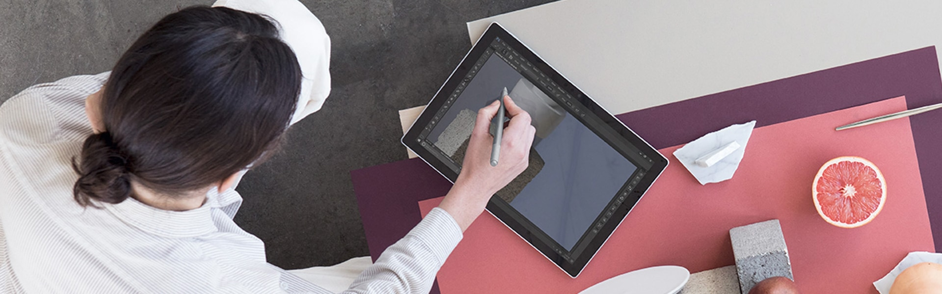 A person draws on their Surface Pro touchscreen with Surface Pen