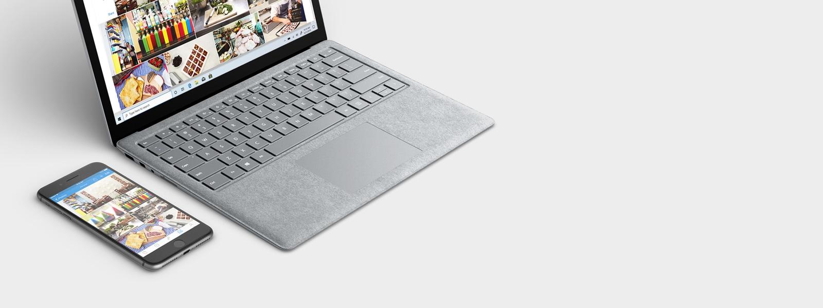 Her iki cihaz ekranýnda da benzer fotoðraflarý gösteren, açýk bir Windows 10 dizüstü bilgisayarýn yanýnda bir cep telefonu.