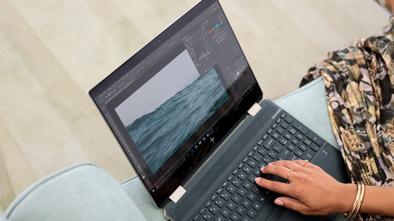 Woman using photoshop on the HP Spectre x360 Convertible