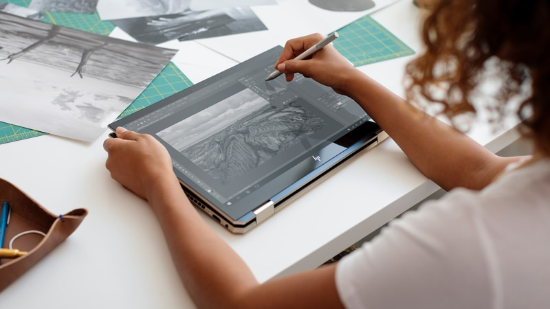 Woman using the HP Spectre x360 Convertible