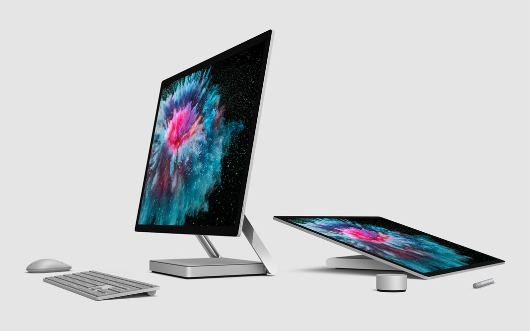 Surface Studio 2 upright and in studio mode with mouse, keyboard, Dial and Pen