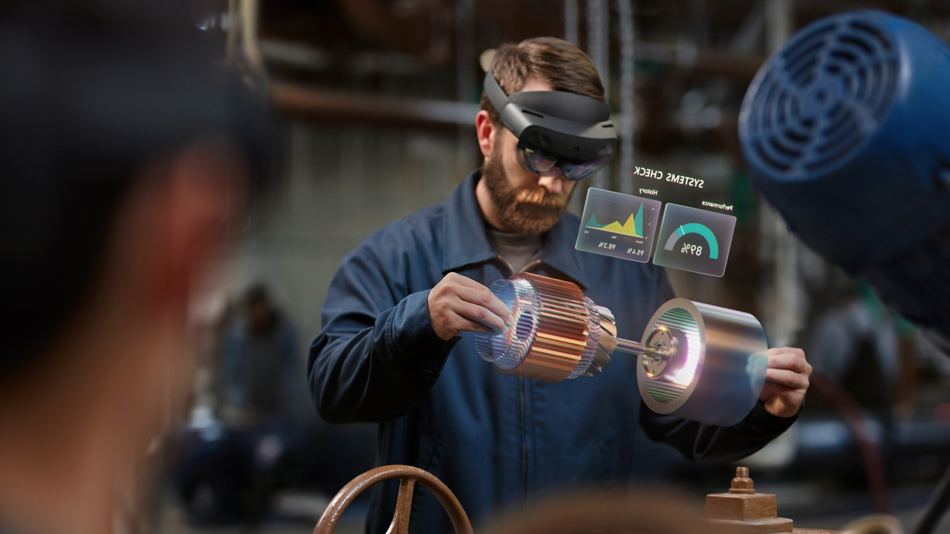 A man uses his HoloLens device at work
