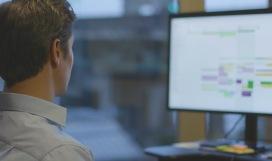 A man viewing an online calendar from his computer