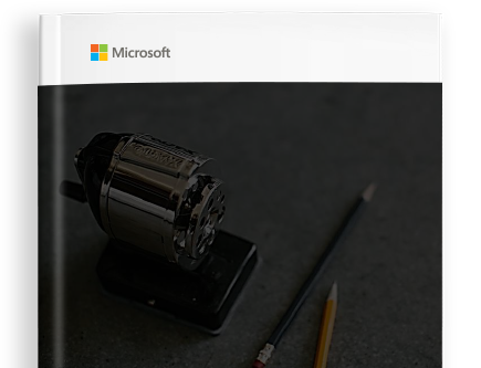 A book cover with the Microsoft logo and a photo of a pencil sharpener on a table next to two pencils