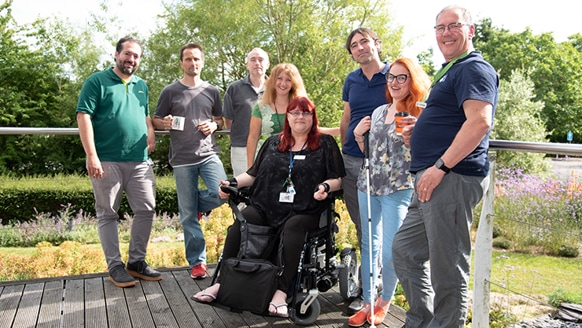 Photograph of team and Disabled Students Group reps.