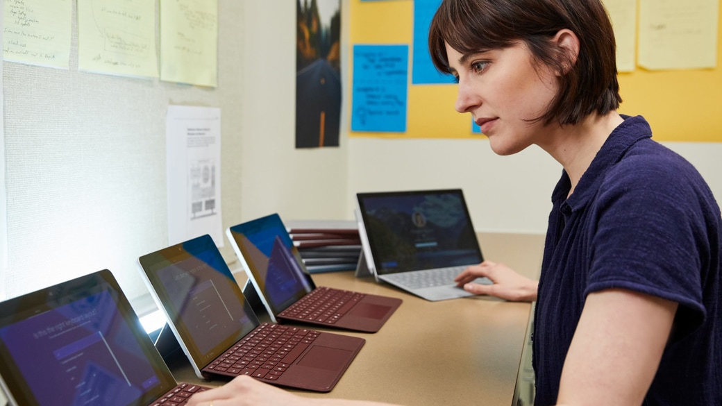 An IT workergetsseveral Surface Go2-in-1laptopsreadyfor deployment to students in her school