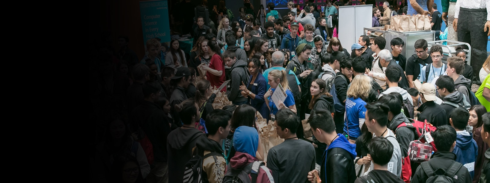 Large crowd of high school students at a TEALS computer science fair