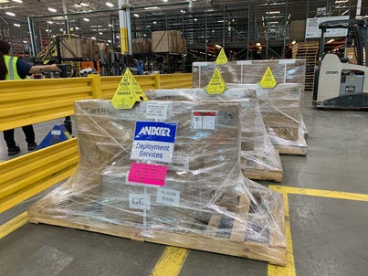 Shrink-wrapped package on wooden pallet