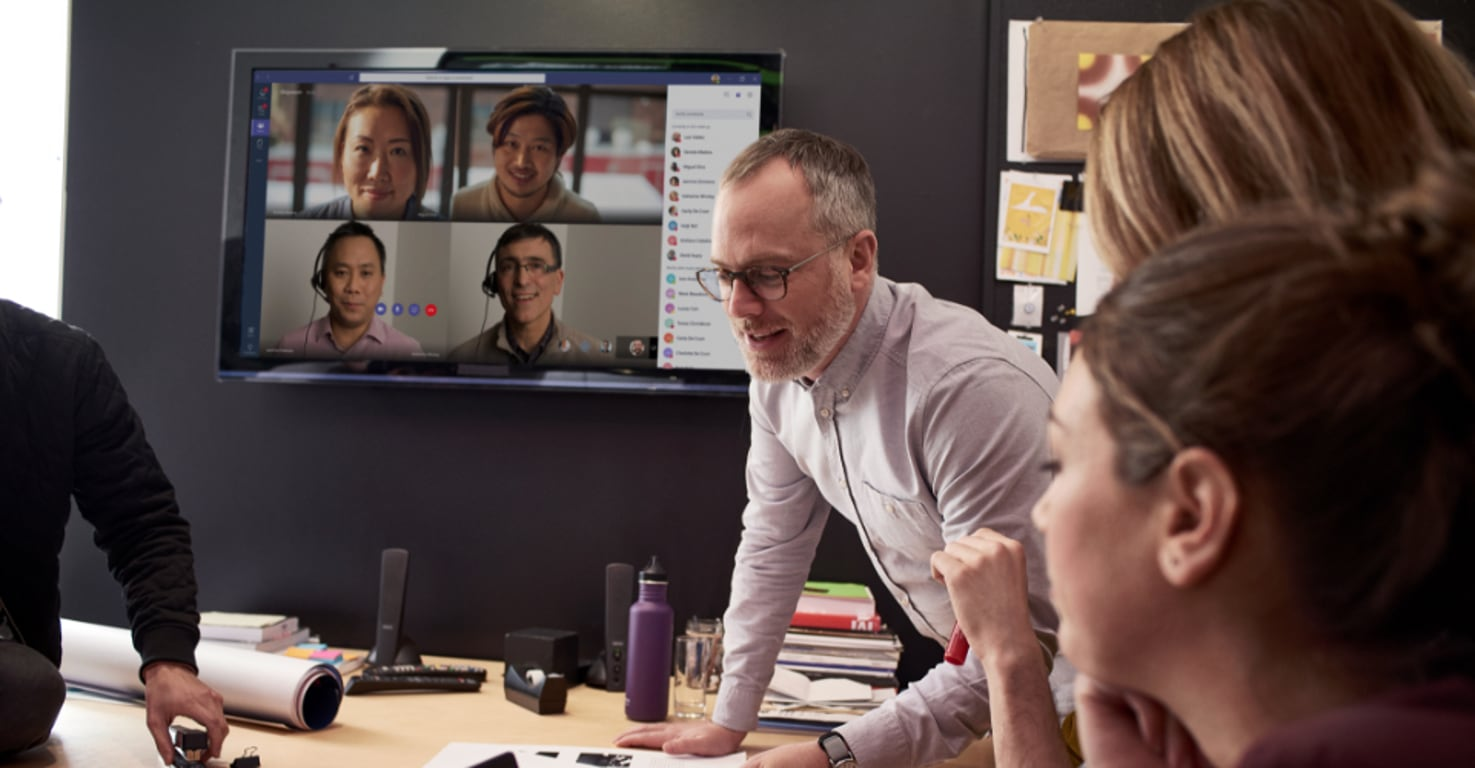 A meeting with people participating in person and online with Microsoft Teams