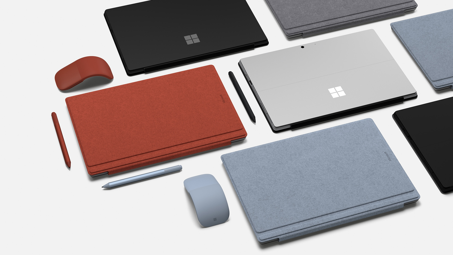 Grouping of Surface Type Covers, Surface Pens, and Surface Mice on tabletop