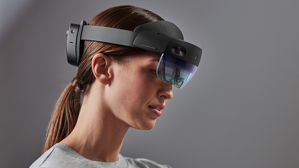 A woman wearing hololens glass and feels it experience