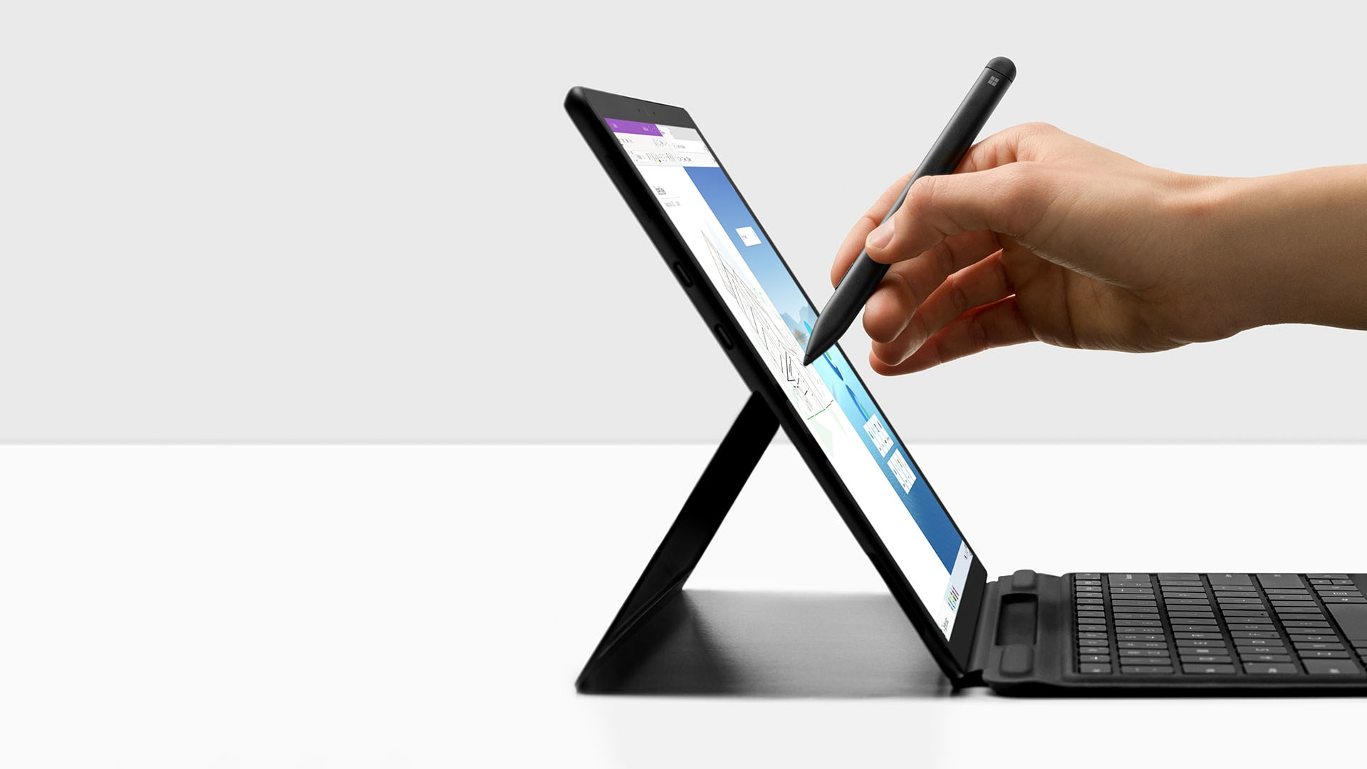 Surface Pro X with Surface Slim Pen being lifted off of Pro X Signature keyboard