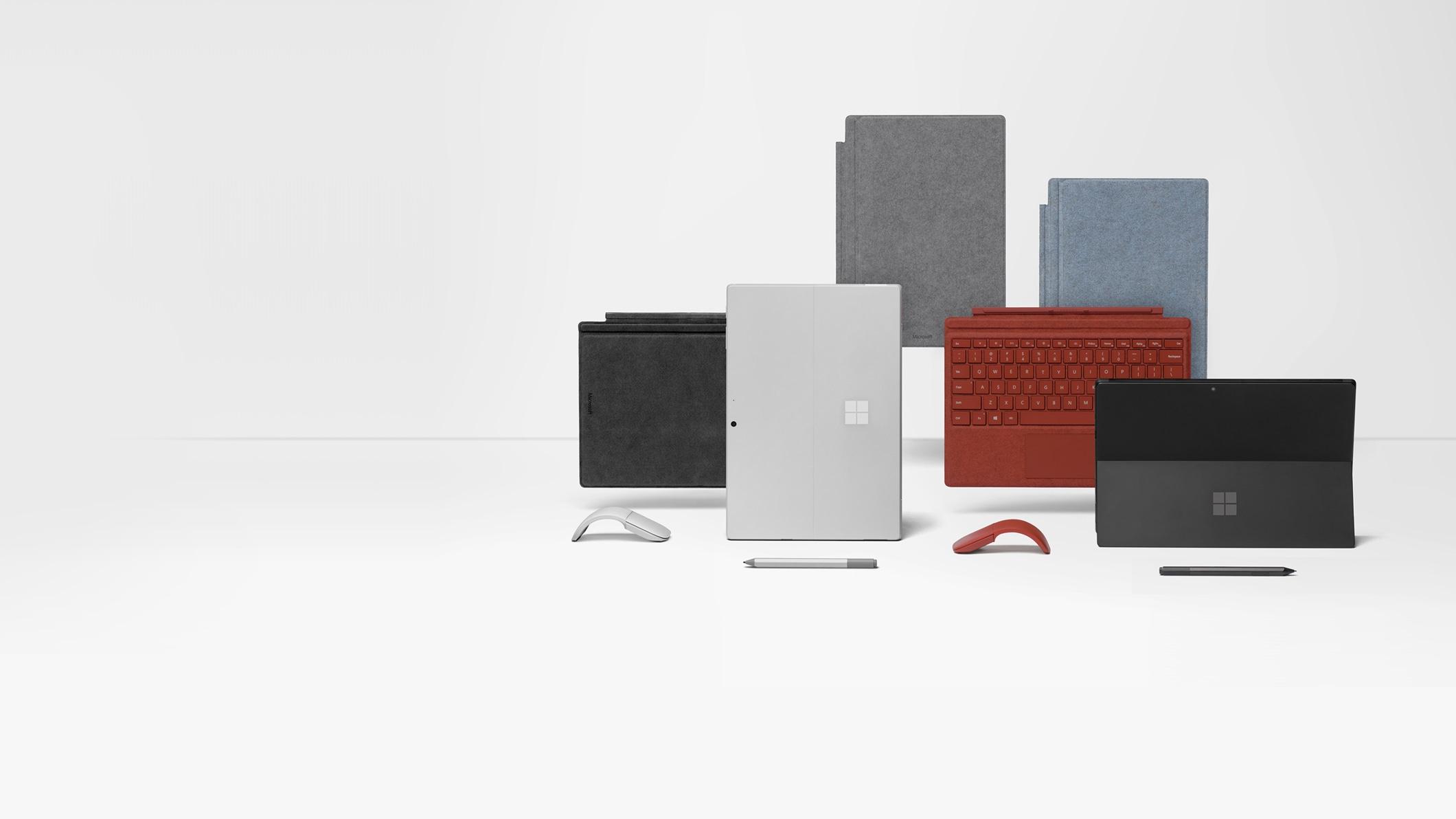 Surface Pro 7  en Negro mate y Platino con varias fundas con teclado y accesorios de colores