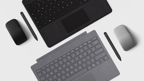 Overhead view of Surface Type Covers, mice and pens