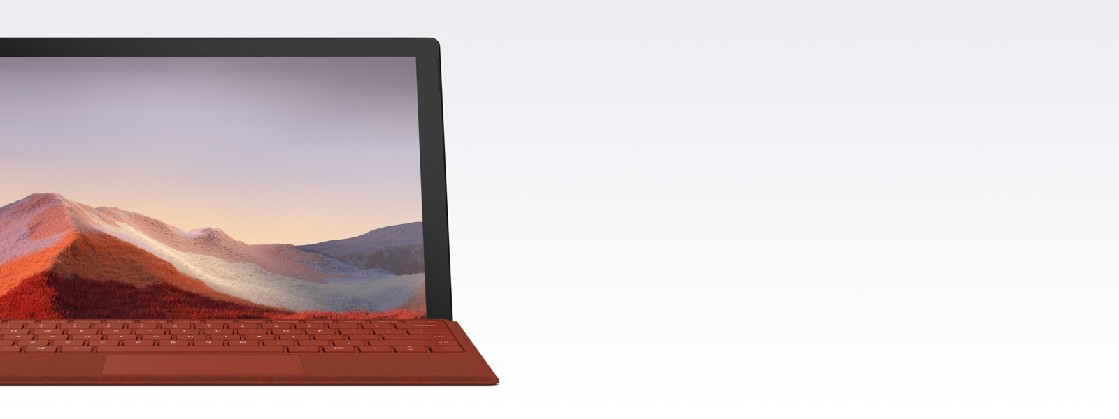 Surface Pro 7  met een klaproosrode Type Cover.
