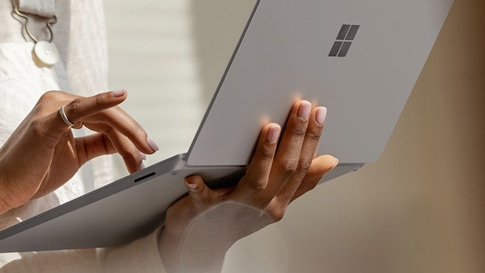 A woman types on Surface Laptop 3