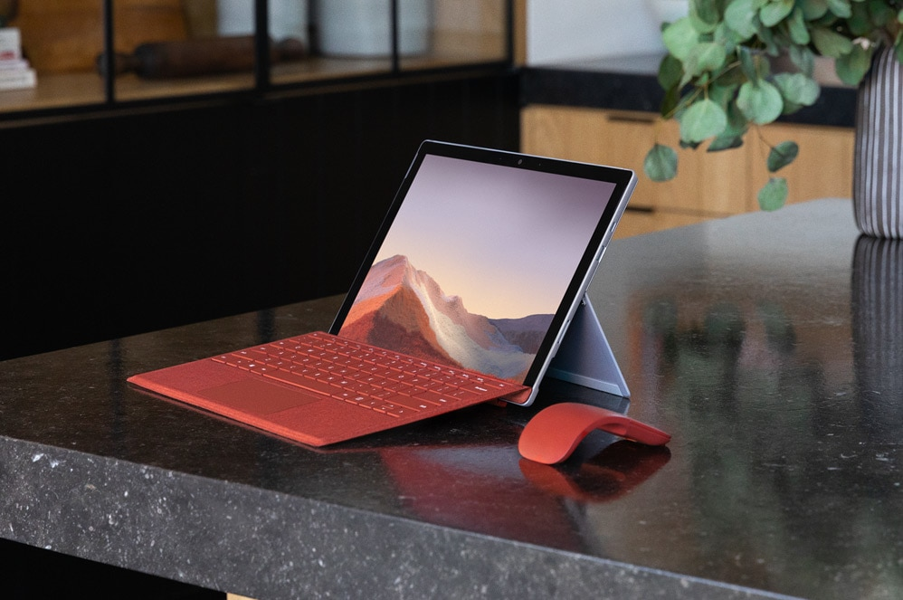 Surface Pro 7 on a table with Type Cover and Arc Mouse