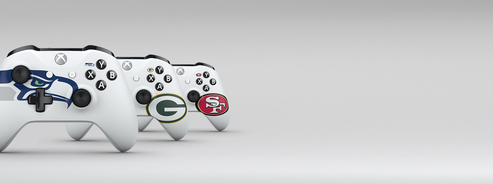 Seattle Seahawks, Green Bay Packers, and San Francisco fourty niners styled xbox one controllers lined up