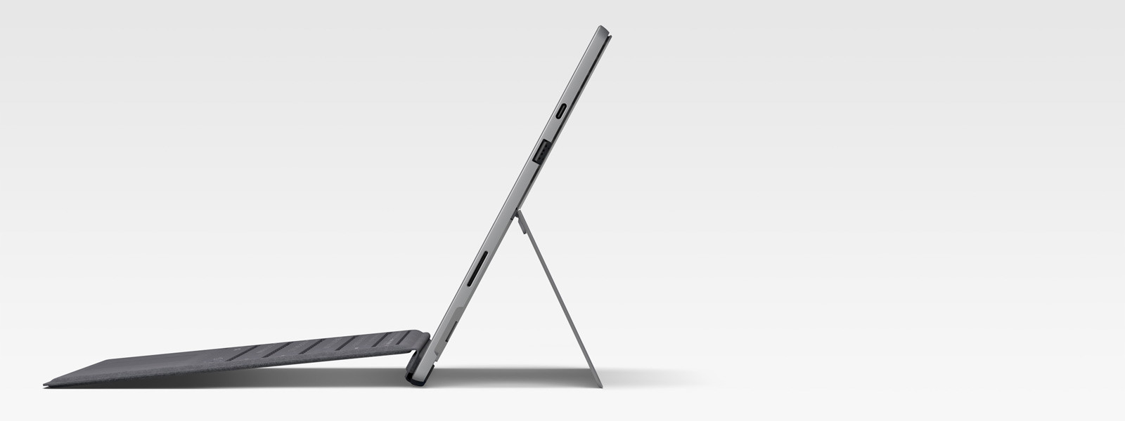Surface Pro 7 In Laptop Mode with Surface Pro Signature Type Cover as seen from side view