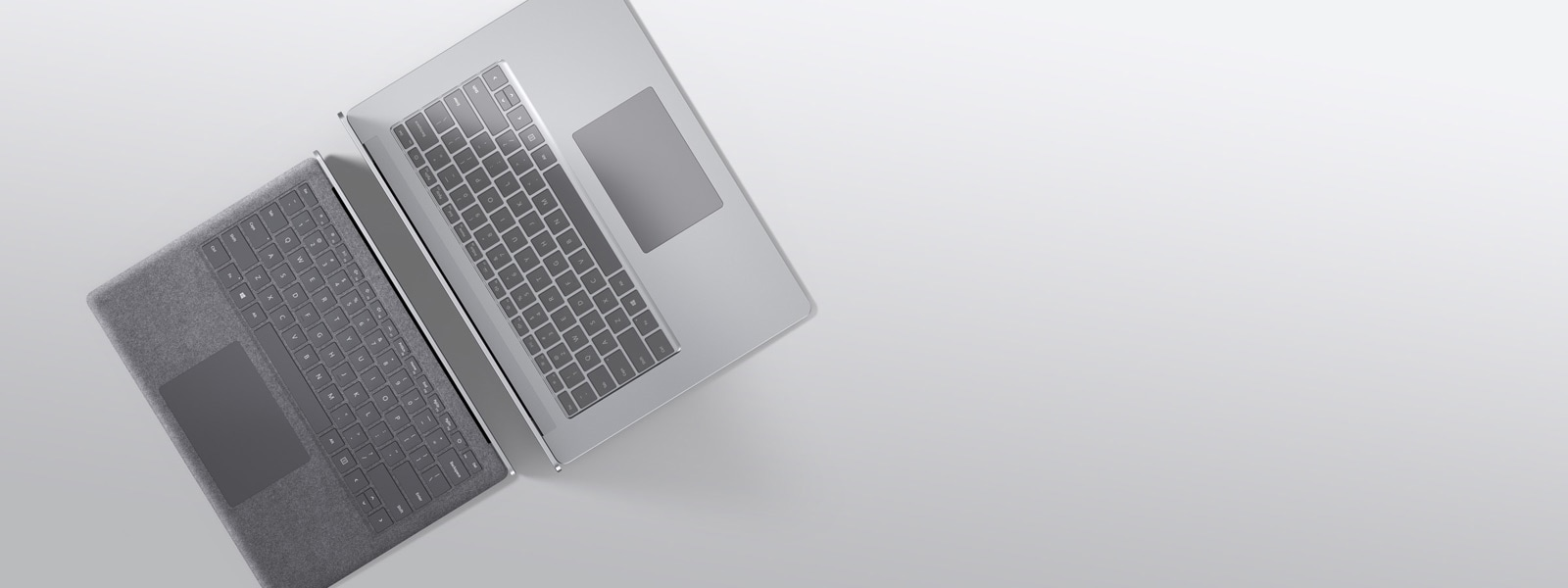 13.5-inch Surface Laptop 3 in Platinum Alcantara and 15-inch Surface Laptop 3 in Platinum metal finish as seen from above