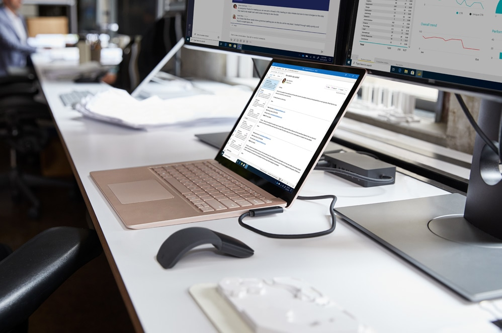 A Surface Laptop 3 in Sandstone on a desk