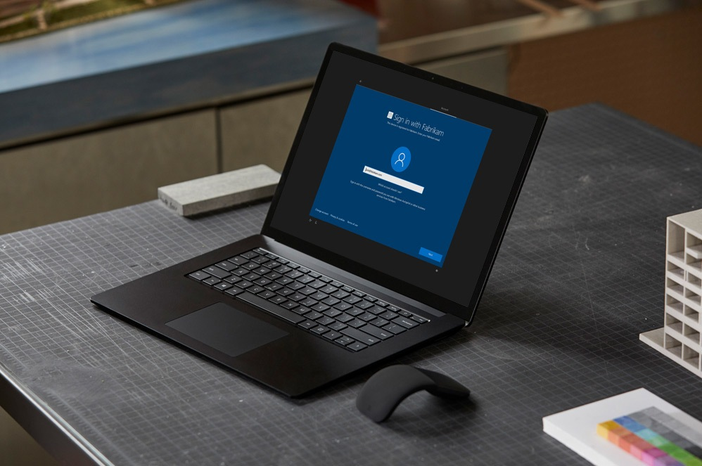 Surface Laptop 3 on a desk with a secure sign-in screen