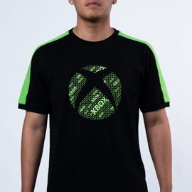 A man wearing the Xbox Color Block Tee in black and green.