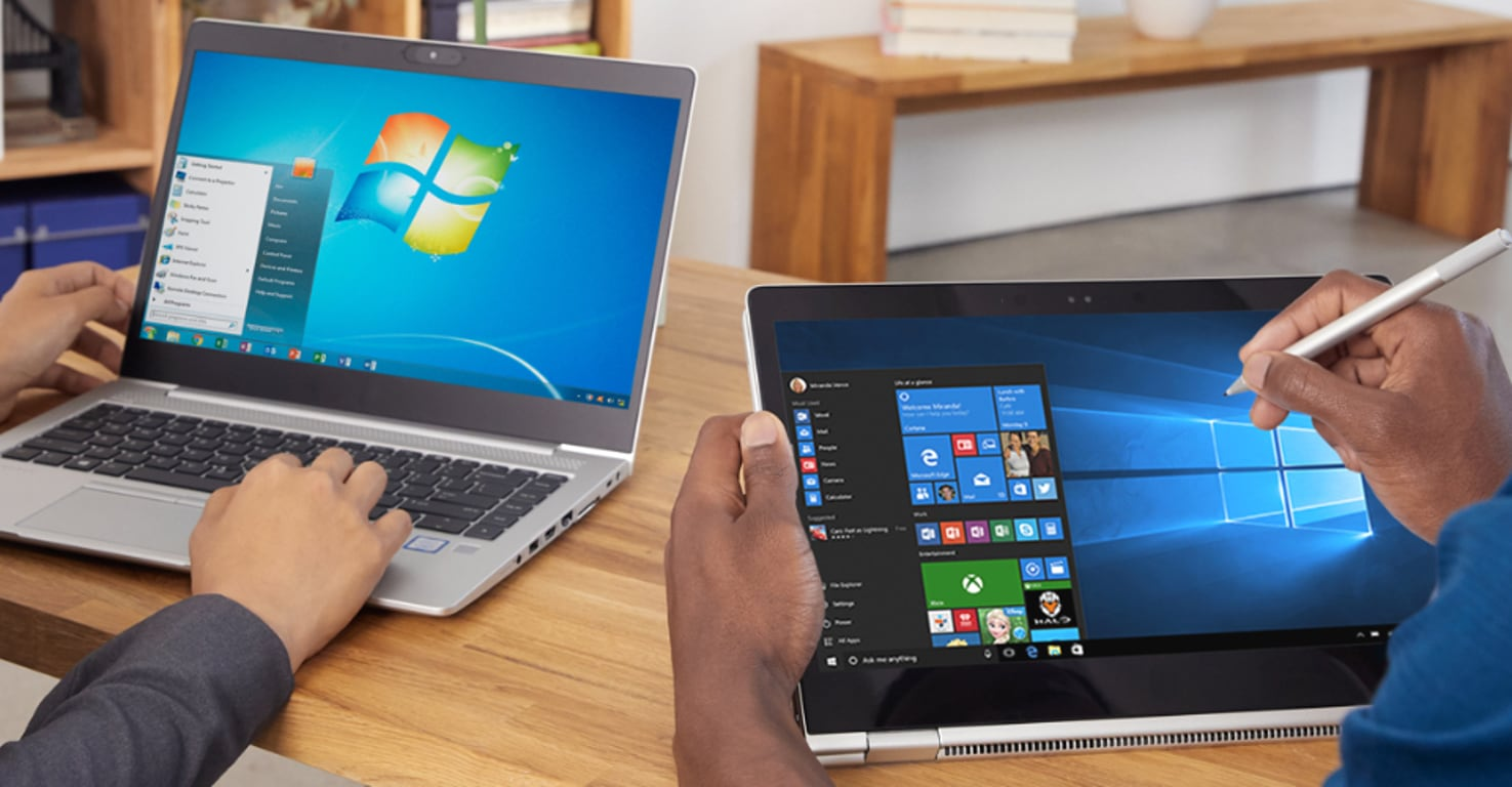 Photograph of a Windows 7 laptop and a Windows 10 laptop