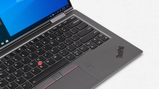 A Lenovo ThinkPad X1 Yoga laptop with a Windows 10 Pro start screen