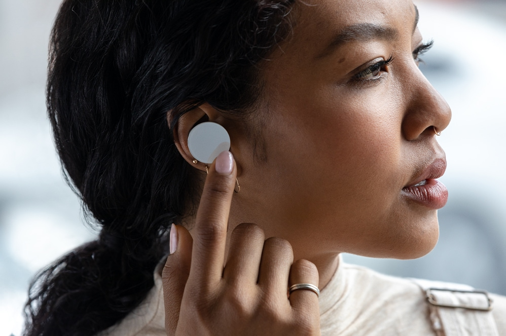Woman wearing the Surface Earbuds