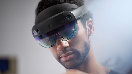 A man wearing a Microsoft HoloLens glass