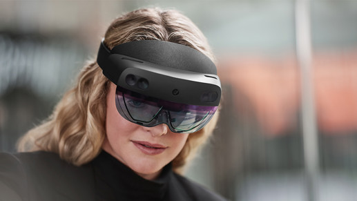 A woman wearing a Microsoft HoloLens glass