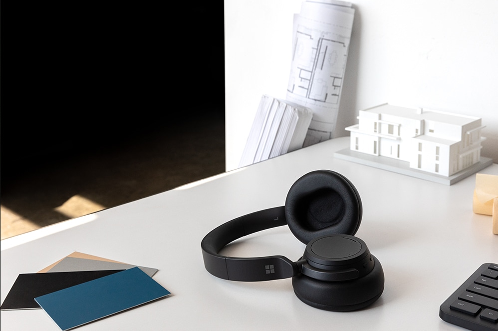 Surface Headphones 2 in Black on a table