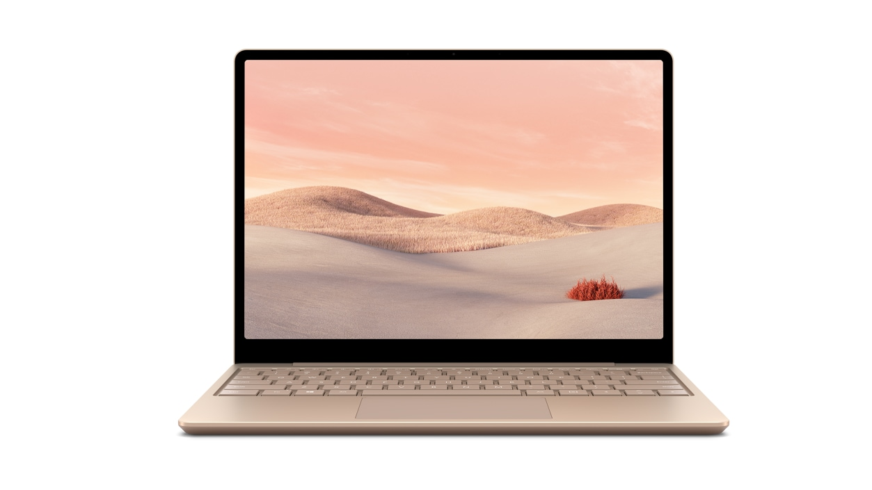 A sandstone Surface Laptop Go sits open against a white backdrop.