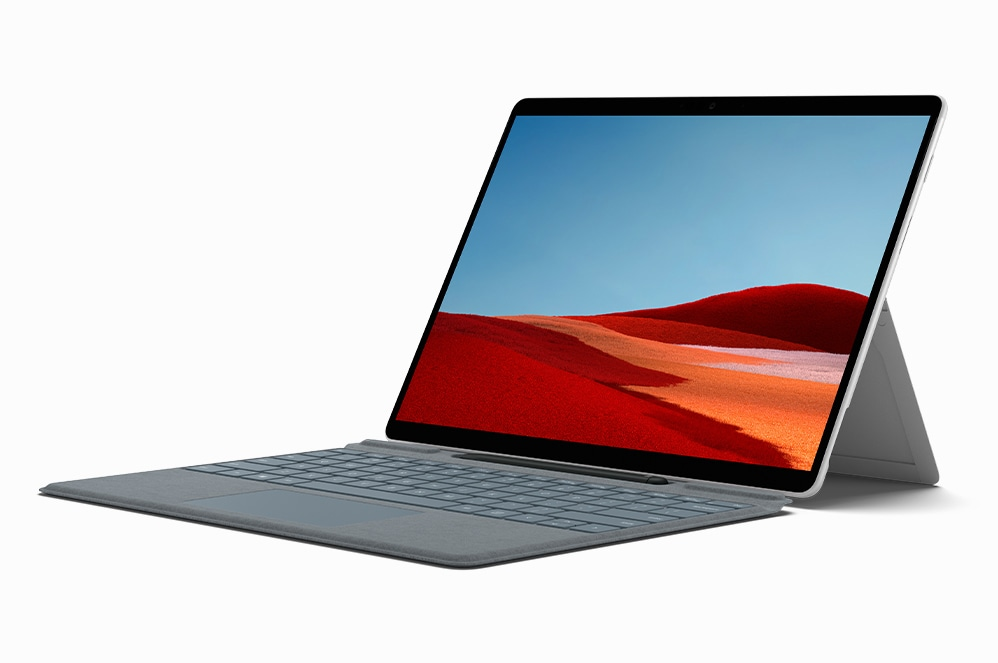 The Surface Pro X device is propped up at an angle with its Pro X Signature Keyboard with Slim Pen Bundle.